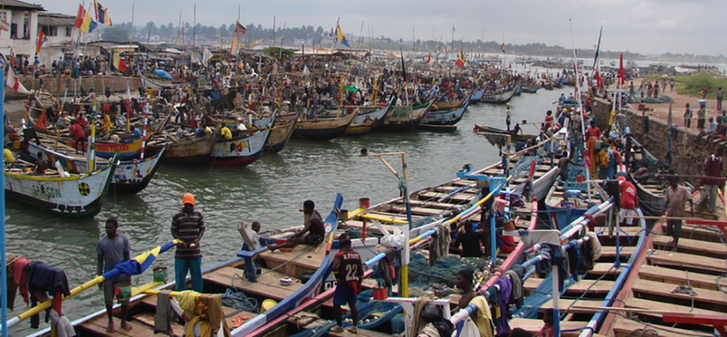 A busy harbor with boats and people