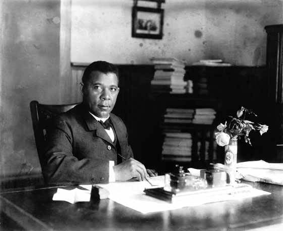 Black and white photograph of Booker T. Washington at a desk.