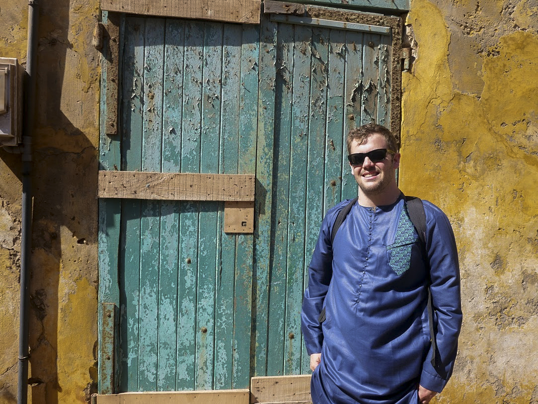 photo of Mike Green in front of african door