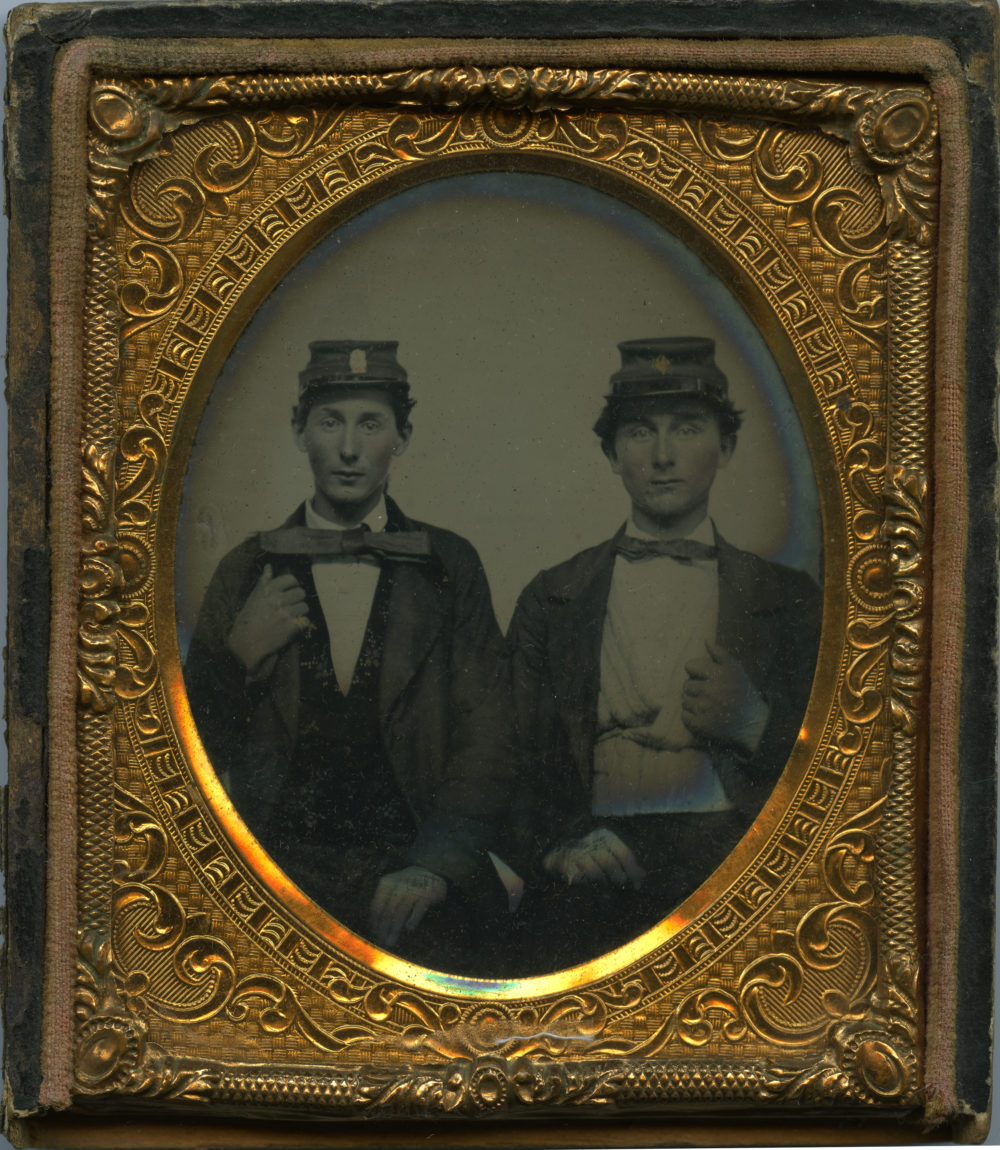 Daguerrotype photo in gold frame of two male civil war soldiers