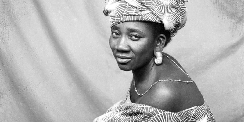 Black and white photo of African woman in a patterned headscarf.