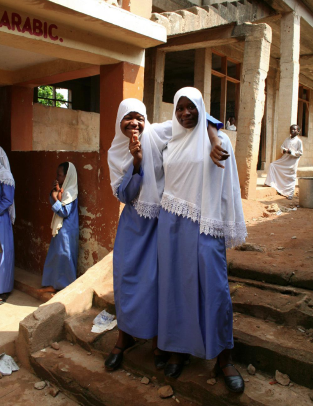 Photograph of two young female Islamic students.
